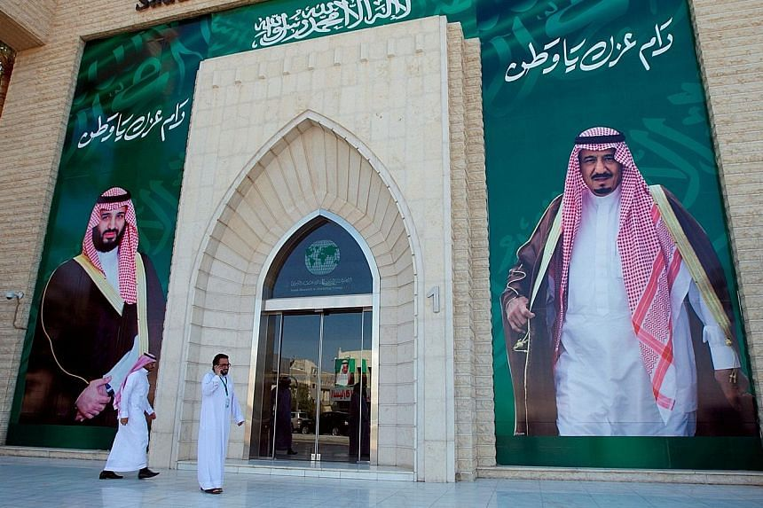 Posters of Saudi Arabia's King Salman (right) and Crown Prince Mohammed bin Salman in Riyadh. The recent arrests of top officials and businessmen is said to be an anti-graft purge, but some see it as a power grab by the Prince.