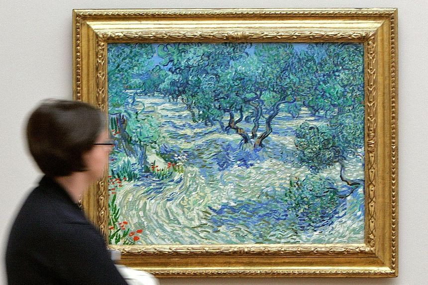 A dried grasshopper has been trapped in this painting, Olive Trees by Vincent van Gogh, for 128 years.