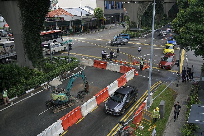 Repairs being carried out after a water pipe burst in Upper Serangoon Road last month. PUB manages a 5,500km pipe network and checks on all pipes at least once a year.