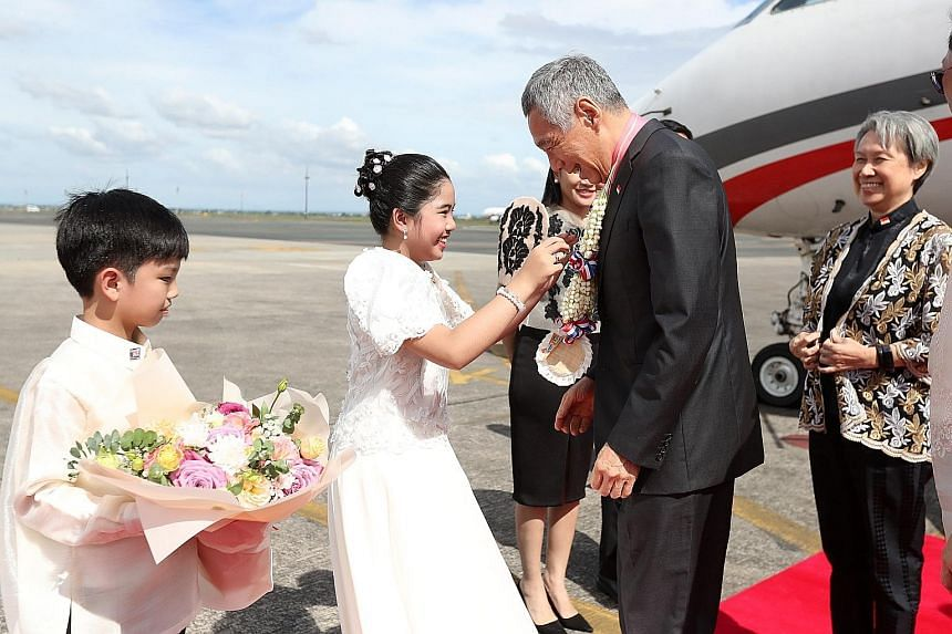 Prime Minister Lee Hsien Loong and Mrs Lee arriving at Clark in the Philippines yesterday. Mr Lee is slated to speak at the Asean-China Summit today, as Singapore is the country coordinator for Asean-China dialogue relations.