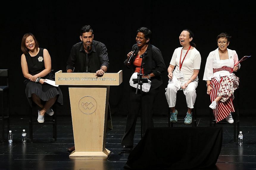 Shoppers at the book store at the Singapore Writers Festival at The Arts House yesterday. Debaters (from left) Petrina Kow, Rishi Budhrani, Shamini Flint, Ovidia Yu and Oniatta Effendi had the audience in stitches at the closing debate of the Singapo