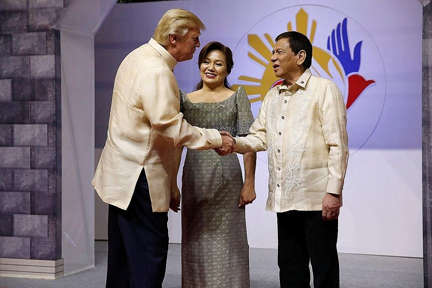 "President Donald Trump being warmly received by President Rodrigo Duterte and his partner Cielito ""Honeylet"" Avancena at a gala dinner yesterday in Manila to mark Asean's 50th anniversary."