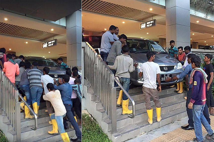 After a video circulated online showing foreign workers moving a car stuck on a flight of stairs at Waterway Point while Singaporeans looked on and snapped pictures, the foreigners were praised as being more helpful than Singaporeans.