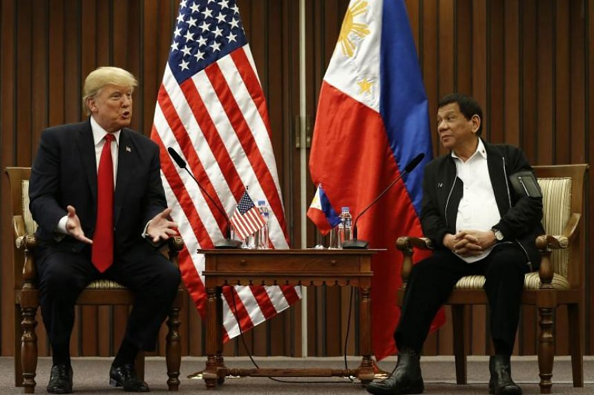 Philippine President Rodrigo Duterte and US President Donald Trump hold a bilateral meeting on the sidelines of the 31st Asean summit and related meetings in Manila on Nov 13, 2017.