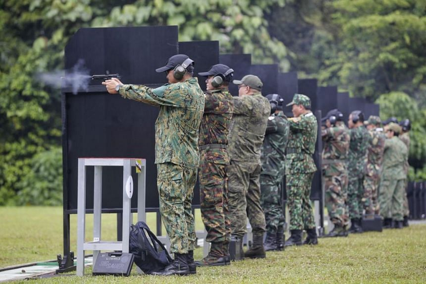 Deputy chiefs of army and senior officers from Asean armies firing pistols during the 27th Asean Armies Rifle Meet opening ceremony at the Nee Soon 500m range on Nov 13, 2017.