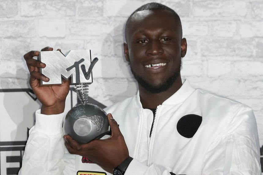 British grime and hip hop artist Stormzy poses in the winners' area with his worldwide act award during the 2017 MTV Europe Music Awards (EMA) at Wembley Arena in London on Nov 12, 2017.