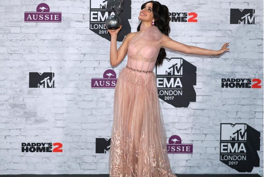 US-Cuban singer-songwriter Camila Cabello poses with her award for Best Pop Act in the winners' area during the 2017 MTV Europe Music Awards (EMA) at Wembley Arena in London on Nov 12, 2017.