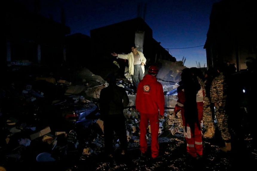 Rescue personnel conduct search and rescue work after a 7.3-magnitude earthquake struck Iran's Kermanshah province on Nov 13, 2017.