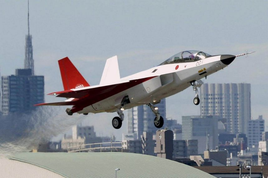 A file photo of the first Japan-made stealth fighter X-2 Shinshin as it takes off to mark its maiden flight at Nagoya Airfield, in Toyoyama town, Aichi prefecture, central Japan.