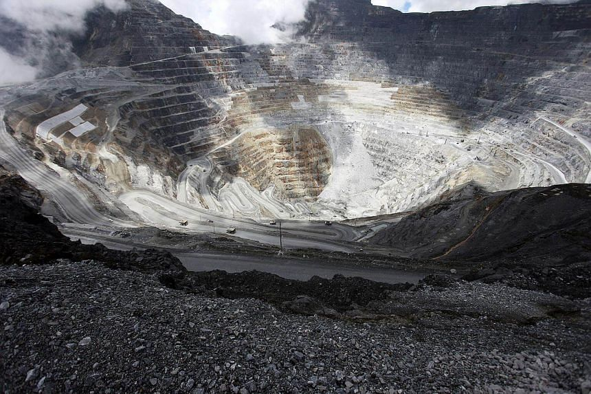 A file photo of trucks operating in the open-pit mine of Freeport's Grasberg copper and gold mine complex near Timika, in the eastern region of Papua, Indonesia.