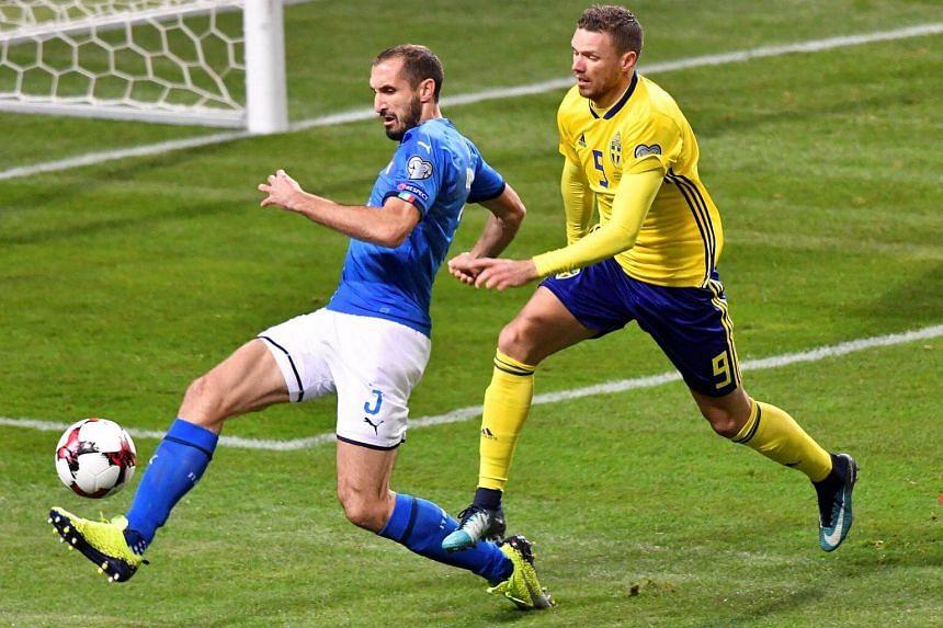 Italy's Giorgio Chiellini and Sweden's Marcus Berg in action.