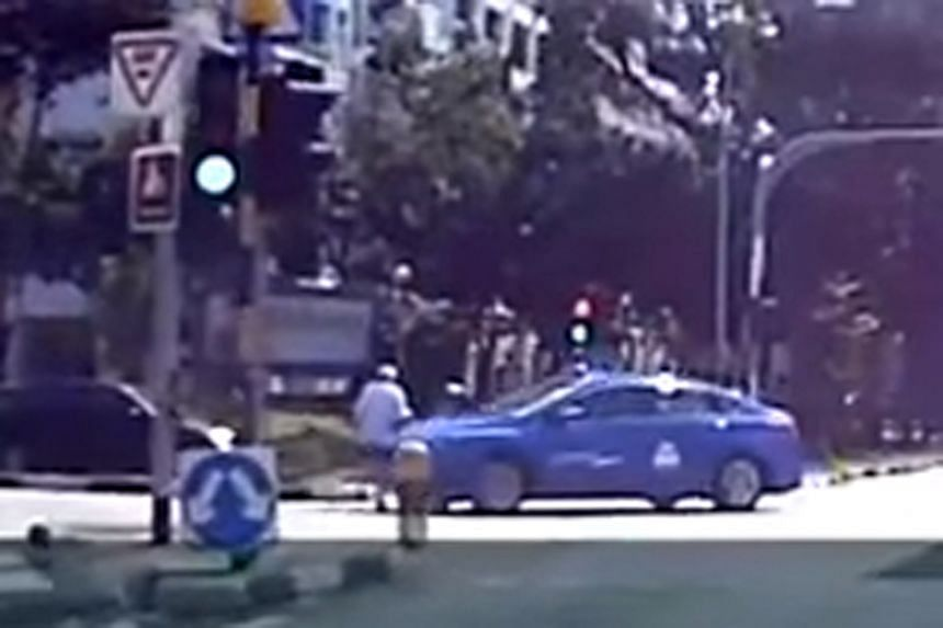 In a video clip showing the incident, the lights are green in the pedestrian's favour.