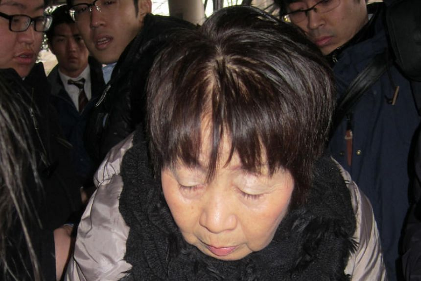 Japanese woman Chisako Kakehi arriving at the Kyoto district court on March 13, 2014.