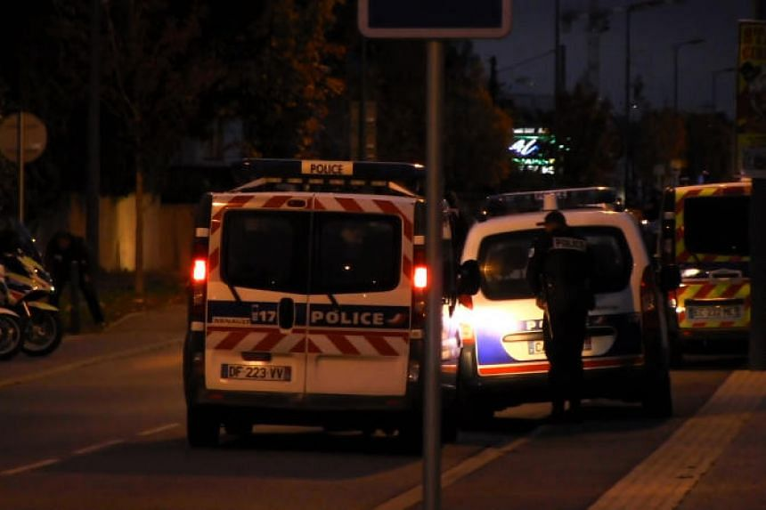 "Police vehicles in a street where a man ""deliberately"" rammed his car into three Chinese students in Blagnac near the southern French city of Toulouse on Nov 10, 2017."