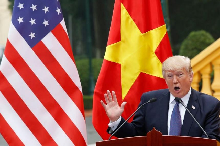 US President Donald Trump at a news conference at the Presidential Palace in Hanoi on Nov 12, 2017.