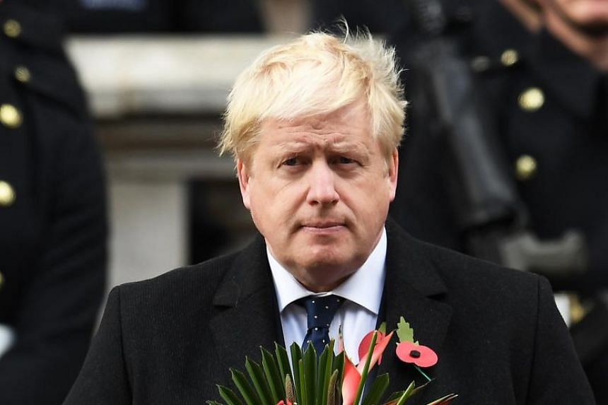 British Foreign Secretary Boris Johnson during the Cenotaph during Remembrance Sunday in London, Britain, on Nov 12, 2017.