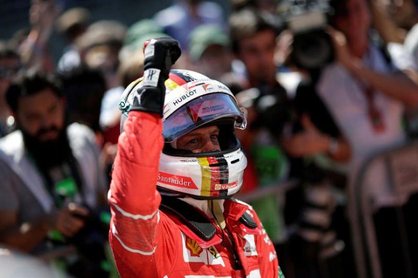 Ferrari's Sebastian Vettel celebrates winning the Brazilian Grand Prix 2017 at Sao Paulo, Brazil on Nov 12, 2017.