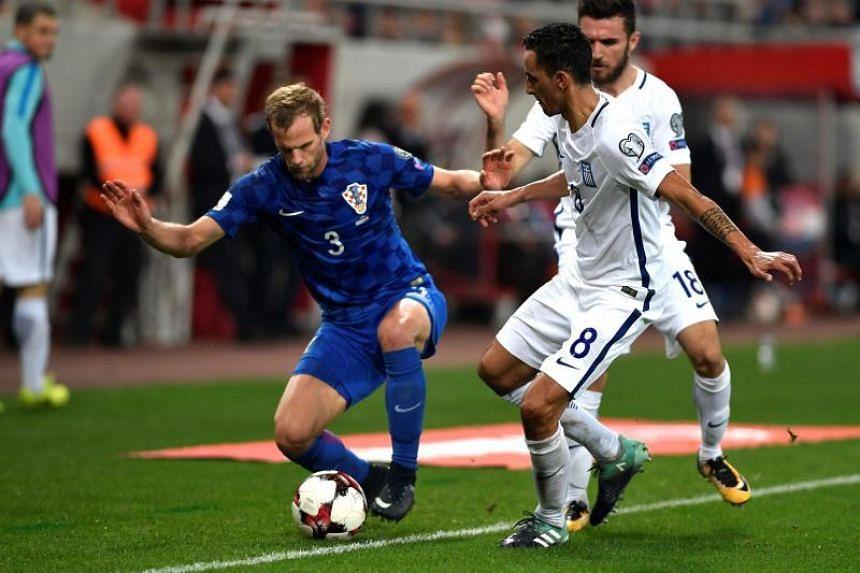 Croatia's Ivan Strinic (right) vies Greece's Zeca during the World Cup 2018 play-off football match Greece vs Croatia, on Nov 12, 2017 in Piraeus.