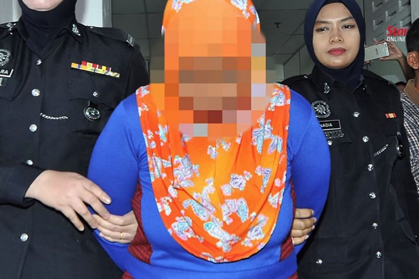 The 39-year-old single mother allegedly charged men RM50 (S$16) a session with her daughters aged 10 and 13.