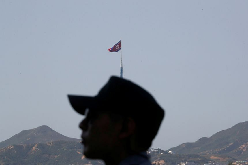 A South Korean soldier stands guard at the propaganda village of Gijungdong in North Korea on Sept 28, 2017.