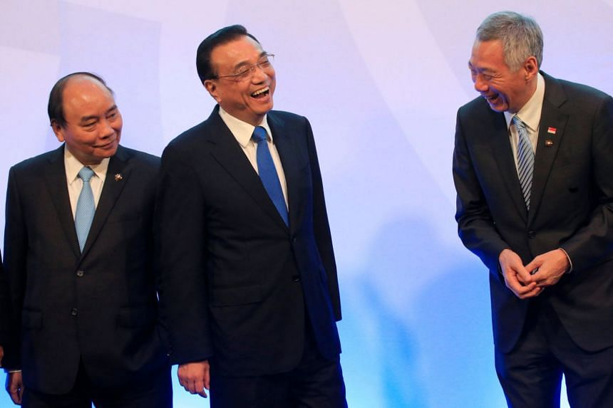 Chinese Premier Li Keqiang (centre) shares a light moment with Singapore's Prime Minister Lee Hsien Loong (right) while Vietnam's Prime Minister Nguyen Xuan Phuc looks on during the 20th Asean-China Summit in Manila on Nov 13, 2017.