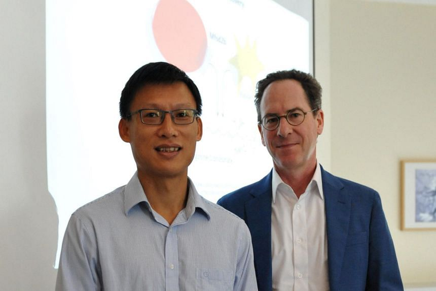 Dr Nguyen Nam Long (left) and Professor Markus Wenk presenting their findings at a media pitch at NUS.