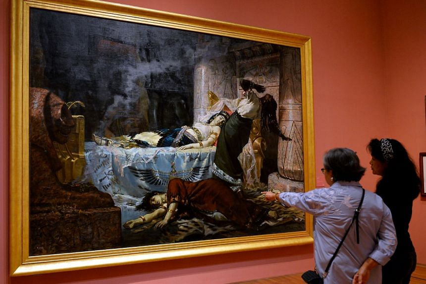 Visitors admiring the painting, Cleopatra by Juan Luna at the National Gallery's Century Of Light exhibition.