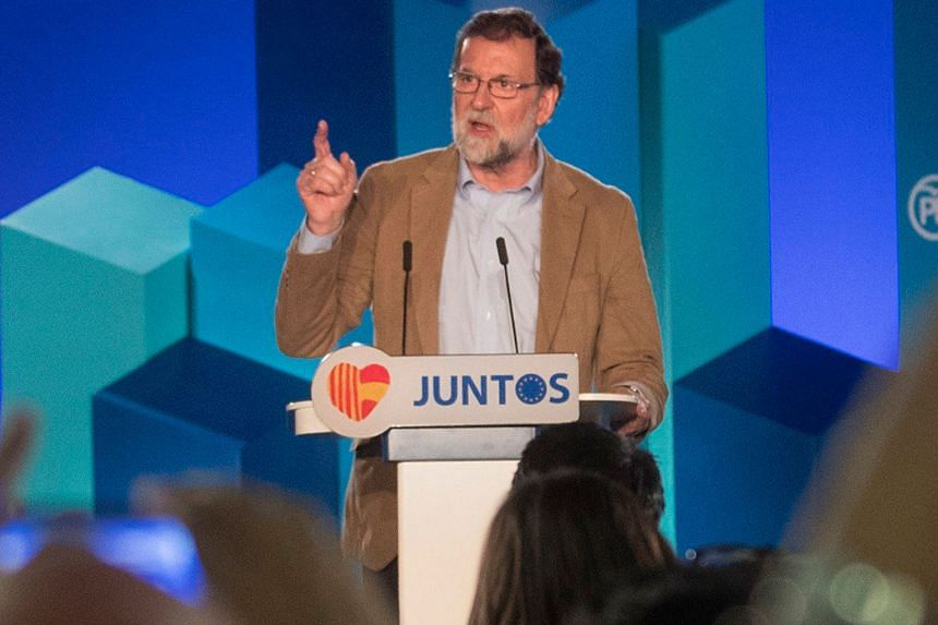 Spanish Prime Minister Mariano Rajoy speaking to members of his Popular Party yesterday at the presentation of his party's candidate, Mr Xavier Garcia Albiol, for Catalonia's regional elections on Dec 21.