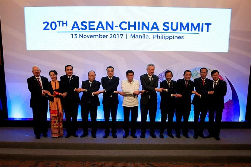 Asean leaders pose for a family photo during the 20th Asean-China Summit in Manila.