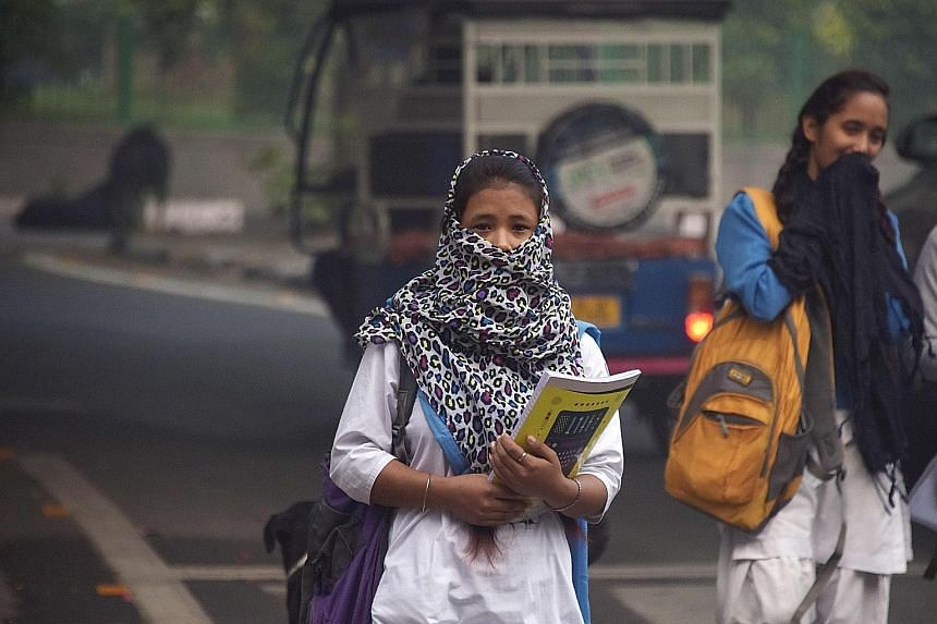 Schools reopened in New Delhi yesterday despite air pollution still hovering at emergency levels, drawing protests from parents in the Indian capital who said the move put children's health in jeopardy.
