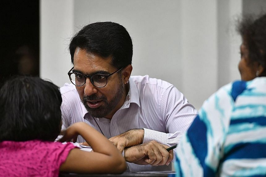 Workers' Party MP Pritam Singh at his Meet-the-People Session in Jalan Damai last night. He has taken on a higher profile than other MPs of late. He was made assistant secretary-general, and chairs the Aljunied-Hougang Town Council and the WP 60th an