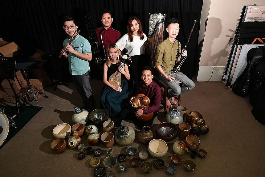 (From far left) Mr Ng Hsien Han, 30, with the dizi; Mr Soh Swee Kiat, 24, with the sheng; Ms Eevian Loi, 25, with the liuqin; Ms Yvonne Tay, 25, with the guzheng; Mr Goh Ek Jun, 26, with the percussion; and Mr Fred Chan, 28, with the erhu.