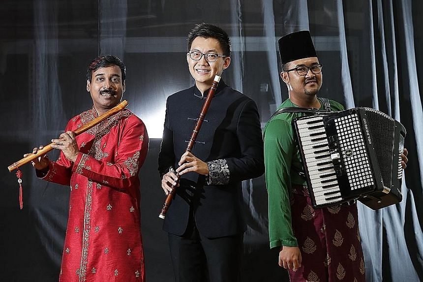 (From left) Ghanavenothan Retnam with his bansuri, Tan Qing Lun with his dizi and Megat Muhammad Firdaus Mohamed with his accordion.