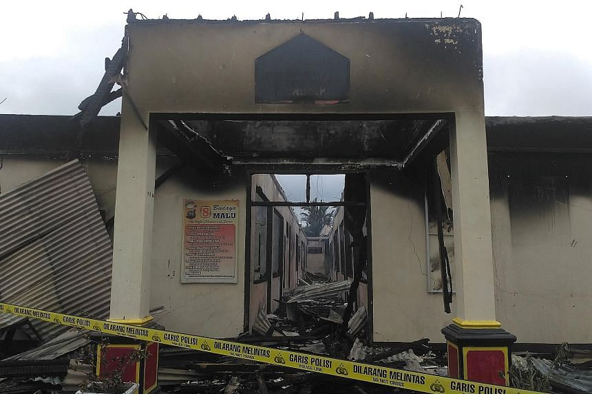 The razed police station complex in Dharmasraya regency in West Sumatra in Indonesia on Sunday. All the main buildings were burned to the ground but there were no casualties.