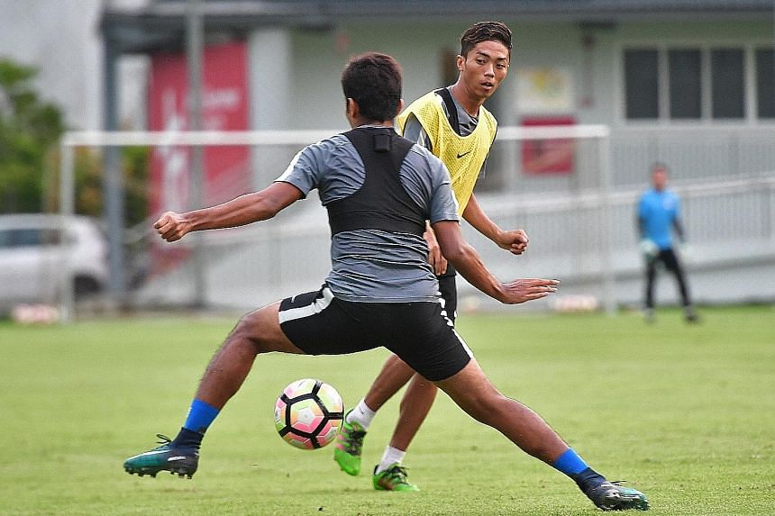 Singapore forward Shawal Anuar (in yellow bib) training ahead of the Lions' Asian Cup qualifier against Bahrain tonight. Anything less than a win will see the Lions eliminated.