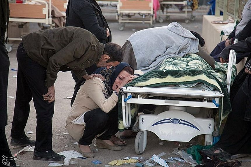A woman grieving for one of the victims of the quake in Iran's Sarpol-e Zahab county, the worst hit in Sunday's disaster.