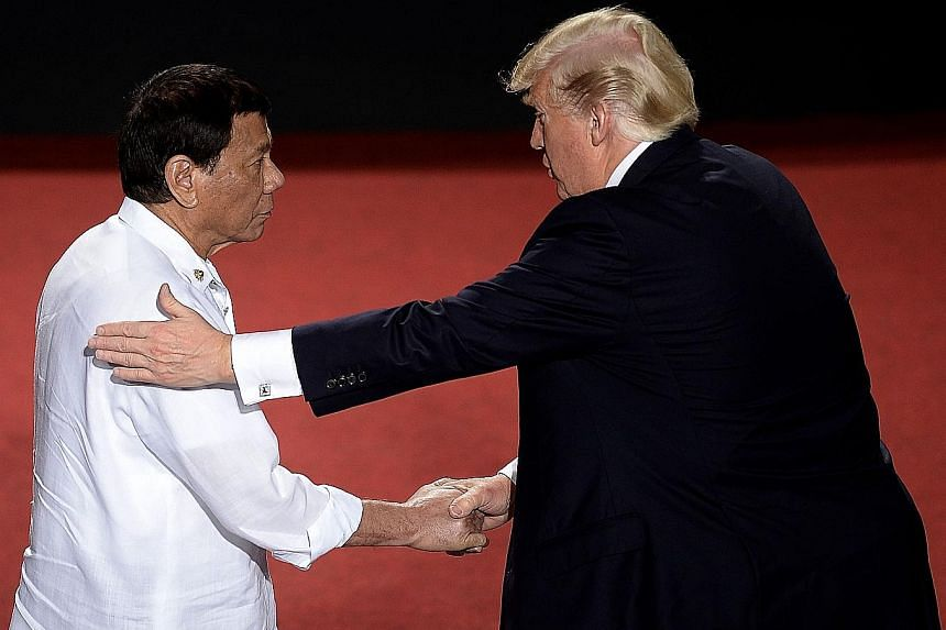 Philippine President Rodrigo Duterte (left) shaking hands with US President Donald Trump during the Asean-US Summit in Manila yesterday. The two leaders also held bilateral talks.