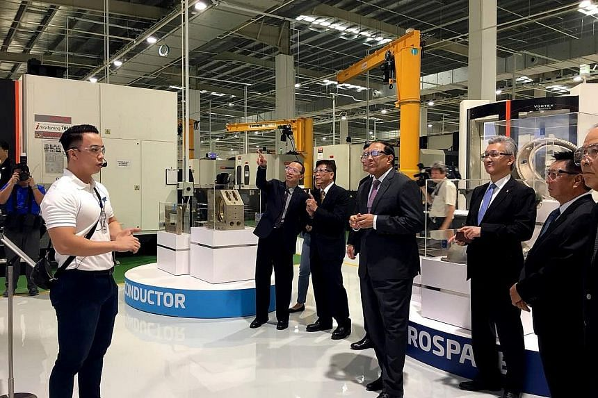 Minister for Trade and Industry (Industry) S. Iswaran touring JEP Precision Engineering's smart factory in Seletar Aerospace Park. The firm invested almost $35 million in the 200,000 sq ft plant, pumping money into technologies which include robotic
