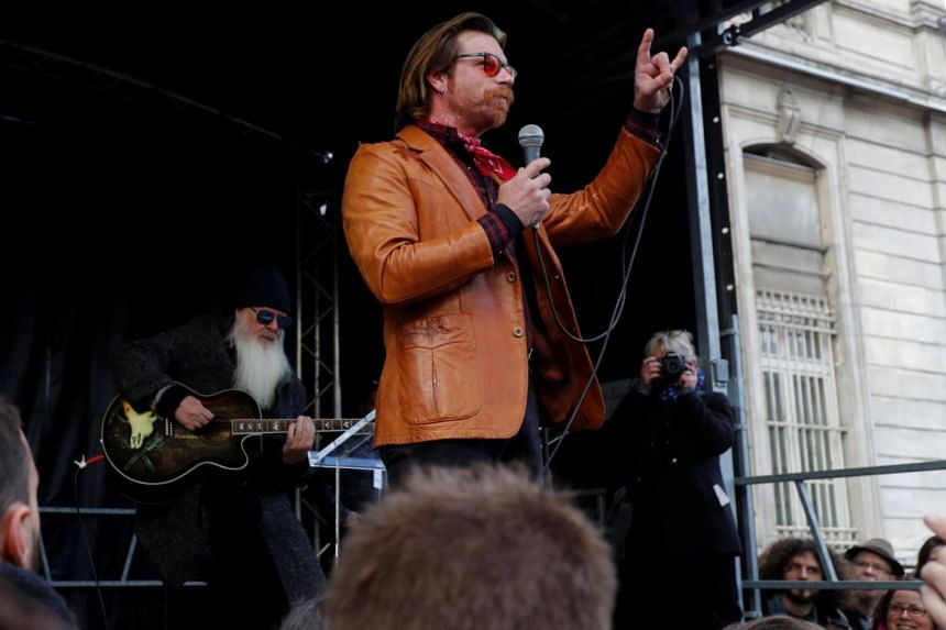 Two members of Eagles Of Death Metal played at a brief concert in Paris to mark the second anniversary of the Bataclan massacre.