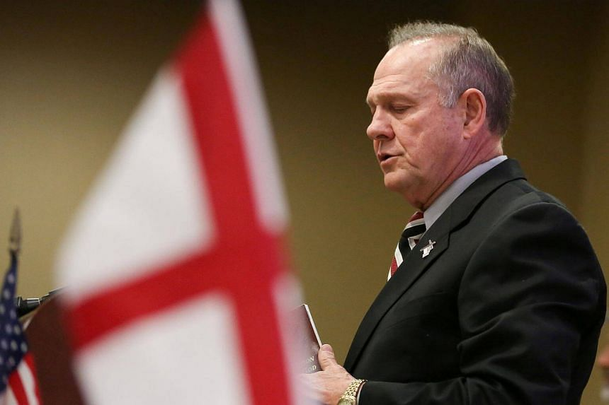 Judge Roy Moore participates in the Mid-Alabama Republican Club's Veterans Day Program in Vestavia Hills, Alabama.