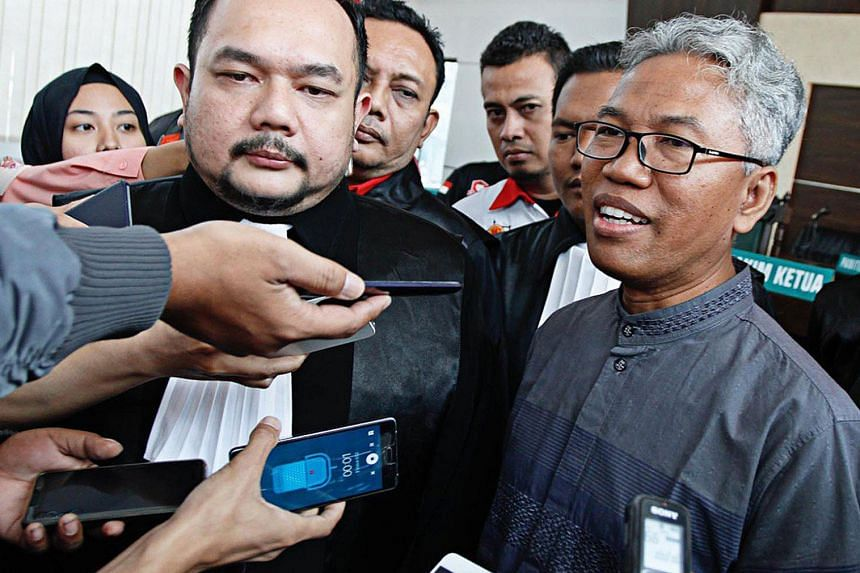Former Indonesian private university lecturer Buni Yani )right) has been was found guilty of spreading hate speech by a Bandung court on Tuesday (Nov 14).