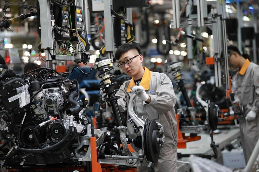 A Chinese employee working on a production line of automobiles at a factory in Changchun.