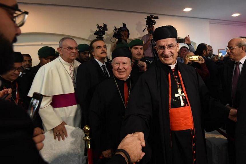 Lebanon's Christian Maronite Patriarch (second from right) greets members of the Lebanese community living in Saudi Arabia at Lebanon's embassy in Riyadh on Nov 13, 2017.