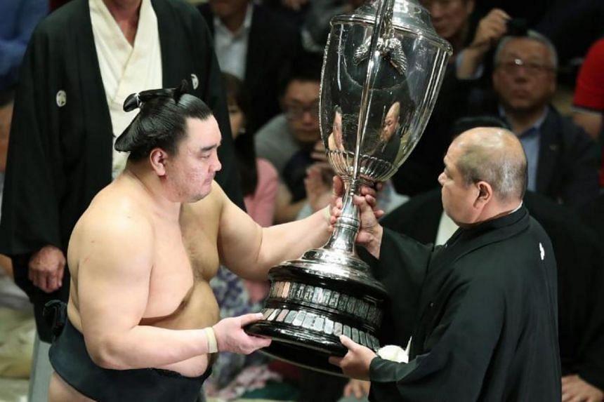 "Mongolian ""yokozuna"", or grand champion, Harumafuji allegedly smashed a beer bottle over a fellow wrestler's head last month."
