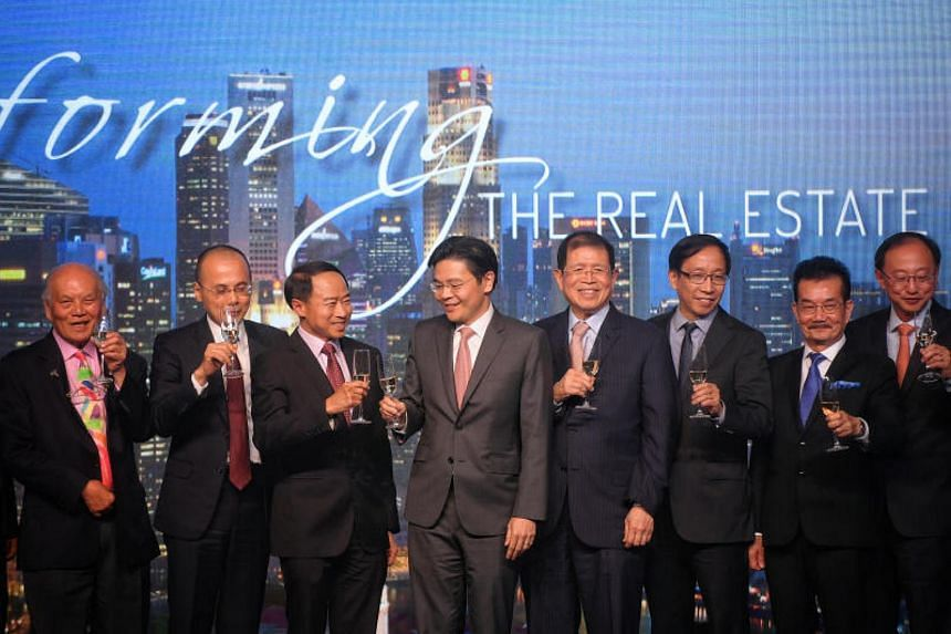 National Development Minister Lawrence Wong (centre) launched the first URA-Redas Spark Challenge at Redas' 58th anniversary dinner on Tuesday (Nov 14).