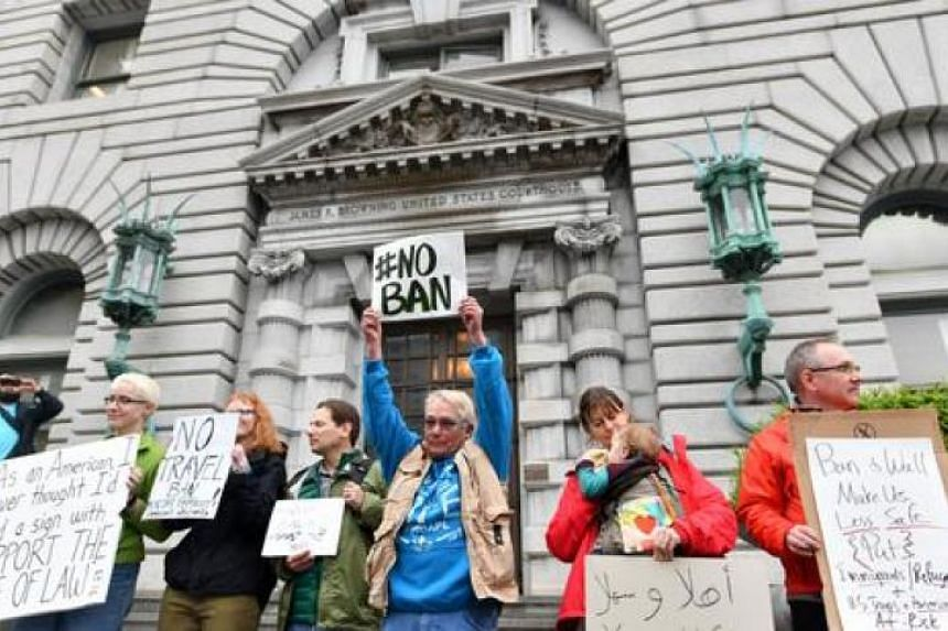 Protesters stand in front of the United States Court of Appeals for the 9th Circuit in San Francisco, California on Feb 7, 2017.