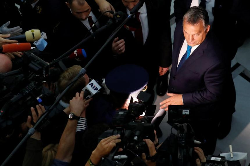 Hungarian Prime Minister Viktor Orban speaks to the media at the Parliament in Warsaw, on Sept 22, 2017.