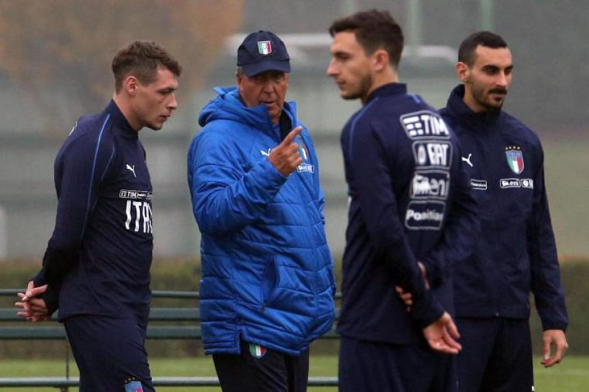 Italy's coach Gian Piero Ventura (2nd from left) speaks with his player Andrea Belotti (left) during a training session in Appiano Gentile, Italy, on Nov 12, 2017.