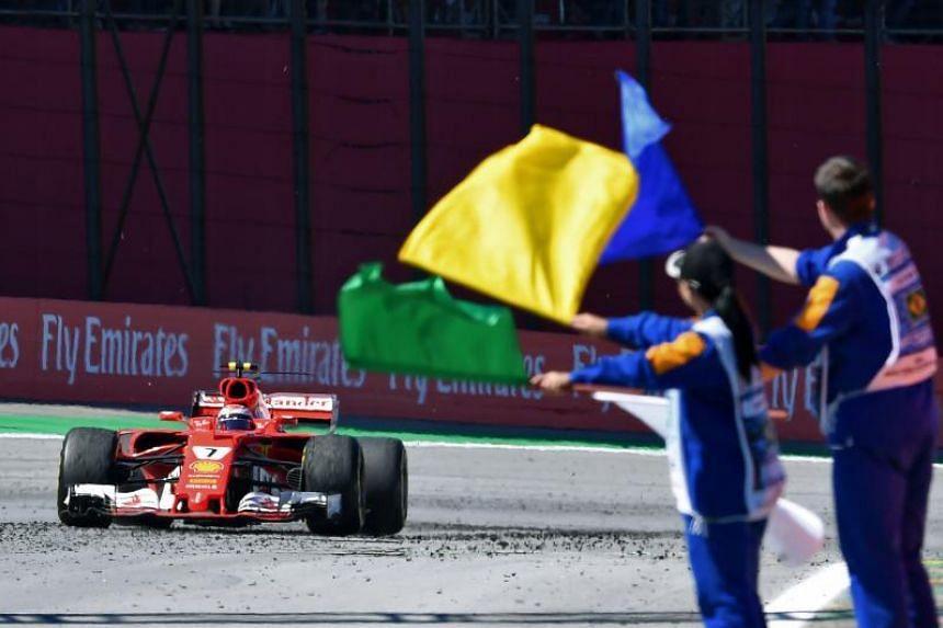 Ferrari's Finnish driver Kimi Raikkonen powers his car ahead of Red Bull's Dutch driver Max Verstappen during the Brazilian Formula One Grand Prix, at the Interlagos circuit in Sao Paulo, Brazil, on Nov 12, 2017.
