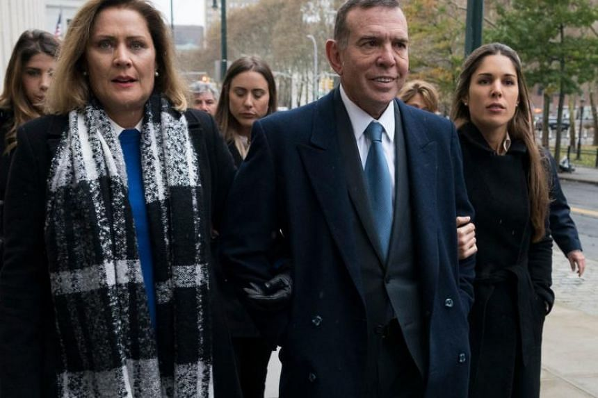 Former Fifa vice-president Juan Angel Napout (centre) of Paraguay arrives at the Brooklyn Federal Courthouse in New York on Nov 13, 2017.